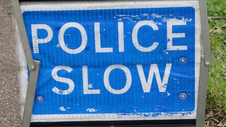 ndg-police-slow-sign-1