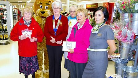 Pictured with Rufus the Barnstaple Lions mascot plus president Jenny Hacker are draw winners Pam Lit