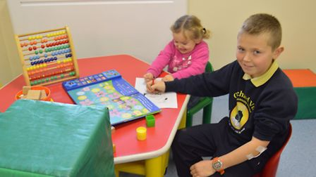 Liberty Hume and Lee Taylor enjoy the facilities in the new children's waiting area.