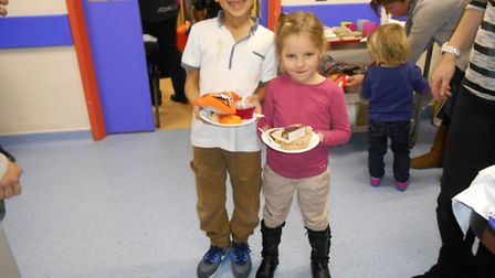 Harley and Sky Johnson enjoy some of the panto refreshments, which were funded by Care for Kids Nort