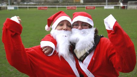 Sisters Sam and Emma Lewis after winning the 3k North Devon Santa Fun Run. Picture: Brian Saunders.