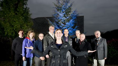 Halwill Christmas tree lights up with Alex Bunney ( Gates Conservation consultant), Emma Middleton (