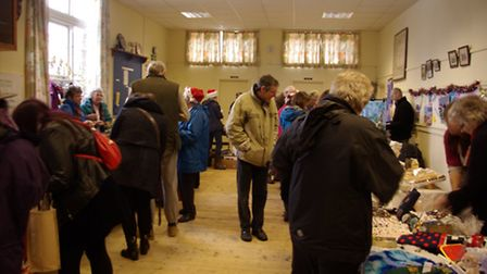 Shoppers go for it in the village hall.