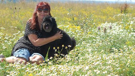 Yelland resident Joanne Bell and her dog Bobby pictured at the site earlier this year, before much o