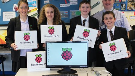 Park School's Head of ICT Mr Williams and students with the free computers from Google