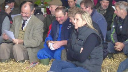 Local dairy farmers gather to improve their knwoledge of bovine behaviour.