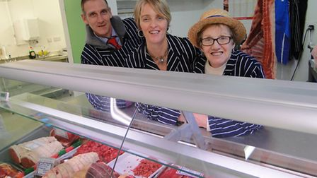 Back in business: Grace Elliott (right) with son and daughter Dudley and Katie at the newly reopened