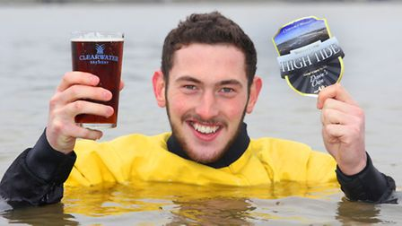 Lewis Butler from the Westward Arms is up to his neck in it while enjoying a pint of Clearwater's Hi