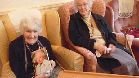 Gladys is pictured with her birthday card from the Queen.