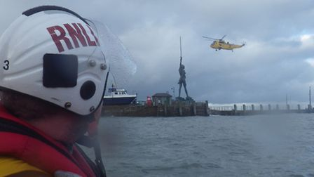 The Chivenor search and rescue helicopter prepares to winch the kayaker on board as the Ilfracombe R
