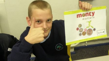 Liam Prewitt, Year 9 student at Holsworthy Community College with the Money Matters booklet.