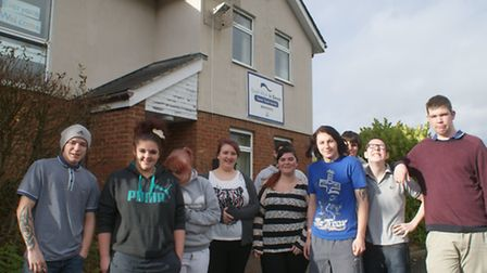 'Georgies' vounteer workers Koren Williams and Kelly Spurway (centre) with young people from the Dev