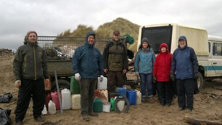 Pictured during the beach clean at Crow are Seamus Ivers, Tom Dyer, Rupert Hawley, Johanne Dyer, Bob