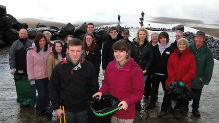 Parry Hill, 16, and Hannah Seymour, 17, lead the way with an army of volunteers to clean the beach.