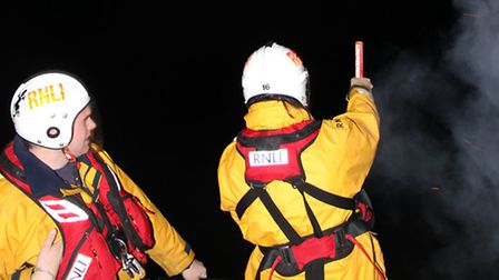 Probationary crew member Jonathon Edwards fires off a parachute flare. Picture: Ilfracombe RNLI.