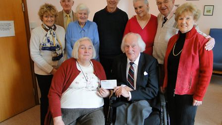 Yvonne Taylor, chairman of the Friends of Bideford Hospital receives the cheque from Bill Parrett an