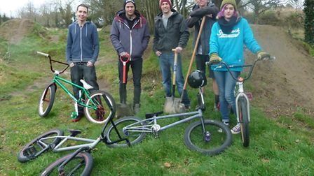 Some of the many people that build and ride at the BMX dirt jump track that until now had informally