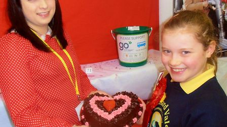 Queen of the cakes Kirsty Kingdom, aged 10, from Barnstaple, is congratulated by Bake Off organiser,