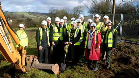 South Molton mayor Stephen White cuts the turf to mark the start of work on the Gullacombes housing