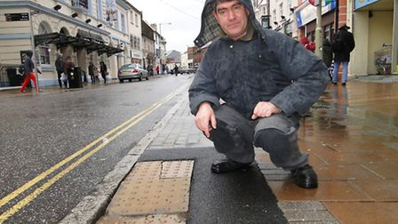 Councillor Simon Harvey with what could be a nasty trip hazard at Bourport Street in Barnstaple.