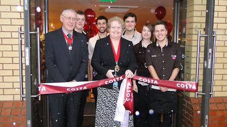 Barnstaple's deputy mayor Val Elkins cuts the red ribbon to officially open the new Costa store.