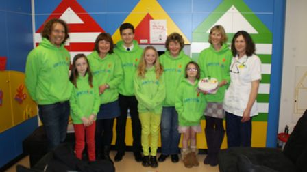 Care for Kids North Devon volunteers and supporters open the new playroom on the Caroline Thorpe war