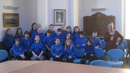 The Eco Group from Ilfracombe Junior School, pictured with volunteer Terry Elliott, are getting invo