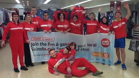Members of North Devon Road Runners and staff from Sainsbury's Barnstaple don onesies at the launch