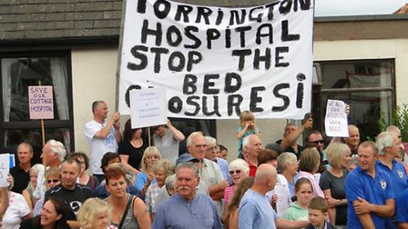 Protesters outside Torrington Hospital when the pilot was announced last year.