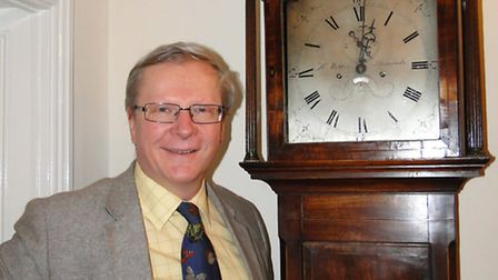 Philip Milton with the 1830s grandfather clock made in Ilfracombe that has returned to the area afte