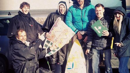 Do0wn but not out: Paul Barrington with his broken board and (left) Matt Knight, Taz Knight, Nick Ll