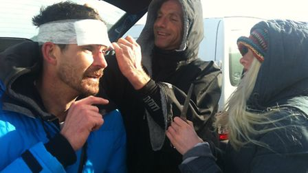 First aider Matt has to miss barrels to apply a bandage after Paul Barrington's tumble. Picture: Nic