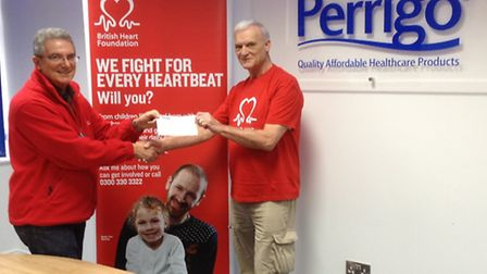 Ian Mortimor-Jackson (right) hands over the cheque to British Heart Foundation's Owen Penney.