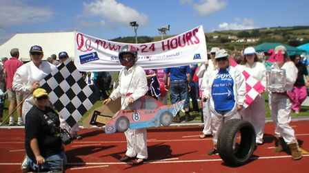 Teams take part in one of the themed laps during last summer's Relay For Life in Braunton.