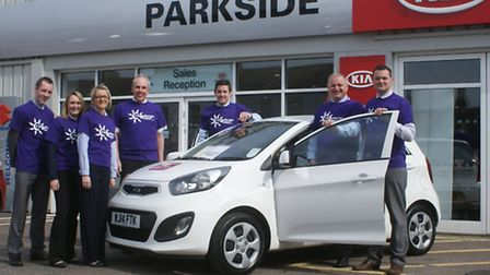 Win a car! County Garages Group marketing director Andy Witherington, Parkside Kia sales manager Joh