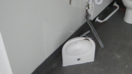 Vandals caused more than £1,000 damage to a disabled toilet at Bideford Football Club.