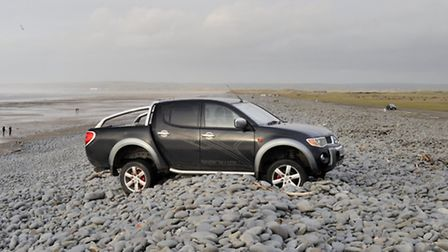 The car became lodged on the Pebble Ridge at Westward Ho! Pic: G&R Photography