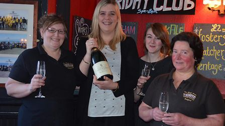 Katie Spearman (second left) is pictured with some of her team.