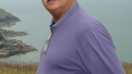 District Councillor Malcolm Wilkinson overlooking Ilfracombe, an area which could be cnosidered for