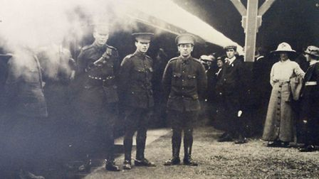 Can you help solve the riddle of this photograph taken at Barnstaple Railway Station in 1914?