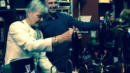The Mayor, Cllr Lynda Courtnadge, pulls the first pint atThe Thatched Inn on opening night, while ma