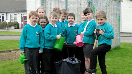 Members of the South Molton Infant School Green Team are pictured with the schools new eco greenhous