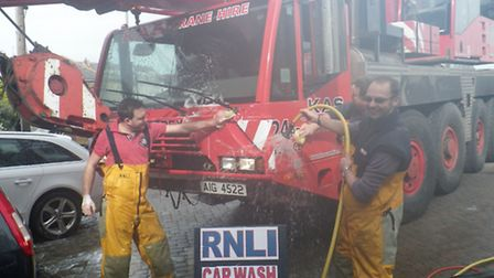 KAS 24 hour crane service having their equipment washed by Ilfracombe RNLI volunteer crew before lif