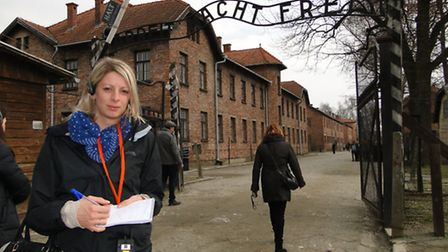 Reporter Sarah Howells at the gates to Auschwitz One.