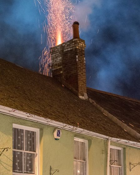Fire crews tackle the chimney fire at The Cavalier Inn, in Well Street, Torrington. This picture was