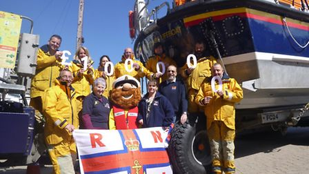 Ilfracombe RNLI volunteers celebrate reaching the £100,000 milestone in the launch and recovery vehi