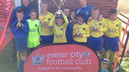 Bideford Blues U11s celebrate another big win at the Exeter City tournament