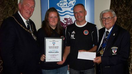 Bideford Ladies coach Mark Lewis and player Nicole Lamey pick up their awards from Devon FA chairman