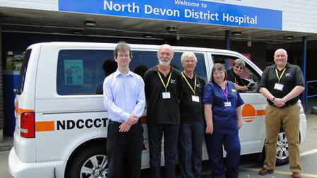 Pictured with thje new transport at North Devon District Hospital are NDCCCT chairman James Bonetta,