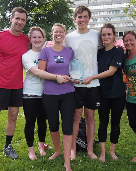 The winning team, Holy Trinity, hold their trophy with pride at the Amigos Fun Day.